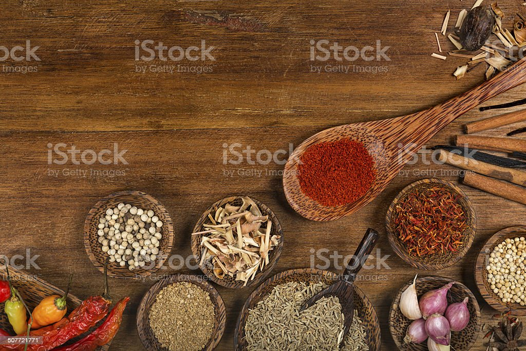 Spices background on a wooden background stock photo