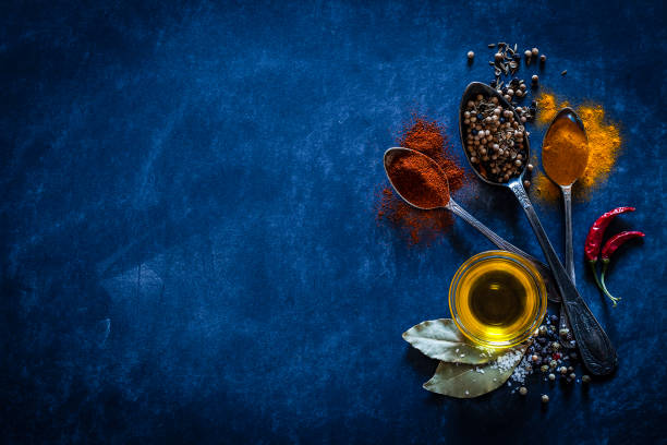 spices background on bluish tint kitchen table - blue powder stock photos and pictures