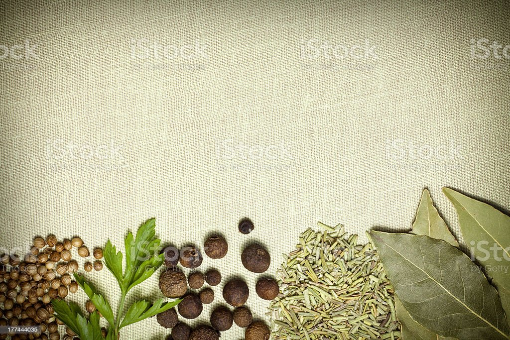 Spices border on vintage canvas royalty-free stock photo