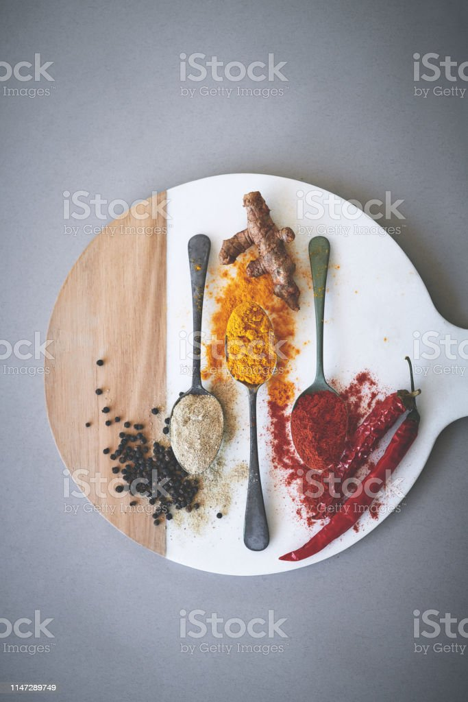 Spices contribute rich flavor to food without adding any calories Shot of an assortment of spices Abstract Stock Photo