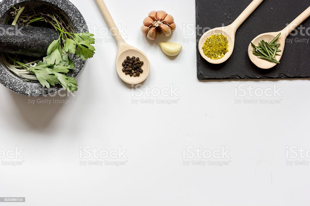 spices for cooking with pounder on white background top view zbiór zdjęć royalty-free