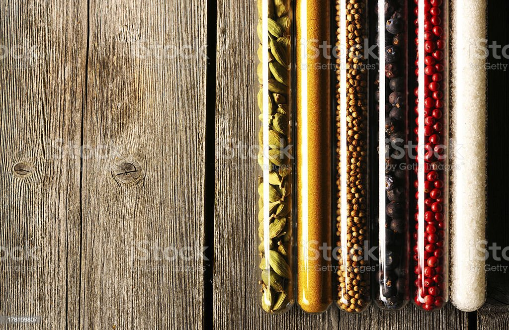 Spices in beakers on wooden table royalty-free stock photo