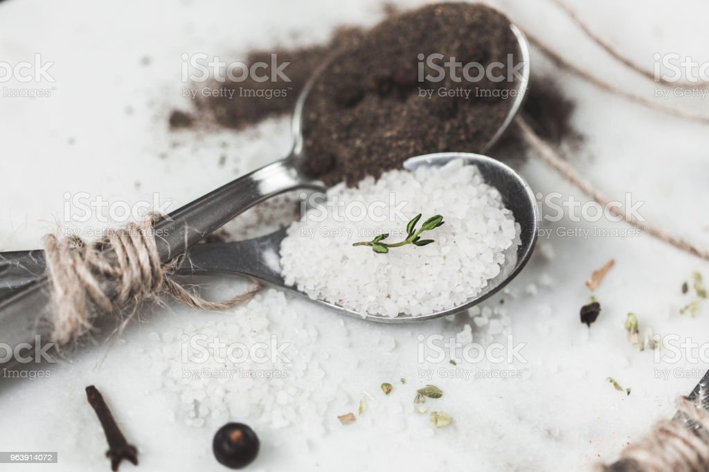 Spices in different spoons on stone marble table background. Rustic vintage color toning - Royalty-free Abstract Stock Photo