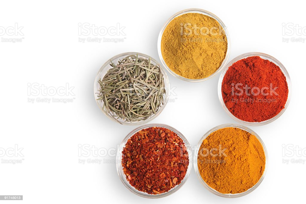 Spices in glass bowls stock photo