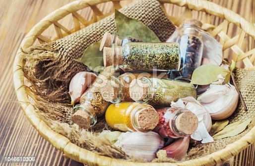 istock spices in jars on wooden background. selective focus. 1046610306