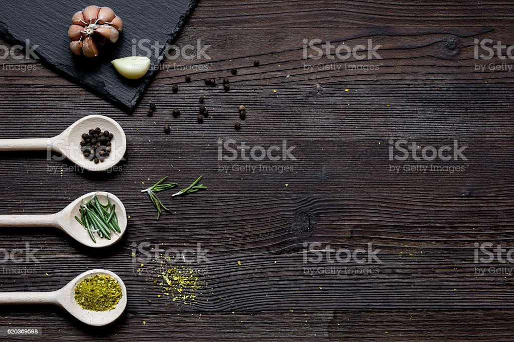 spices in spoon on wooden table top view zbiór zdjęć royalty-free