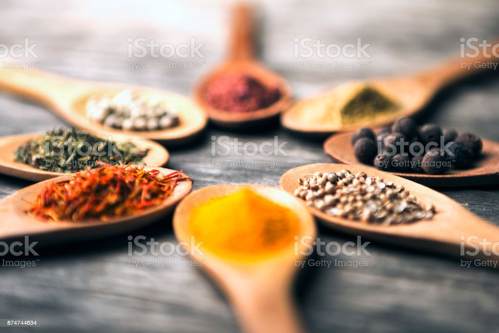 Spices in spoons arranged in circle stock photo