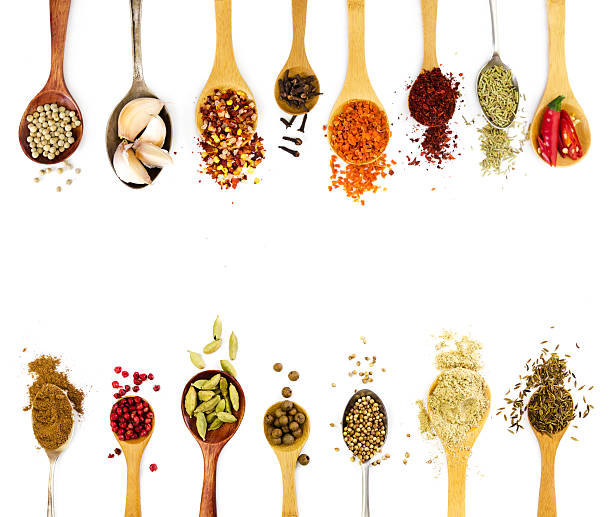 spices in spoons isolated on white background. - pepper seasoning stock photos and pictures