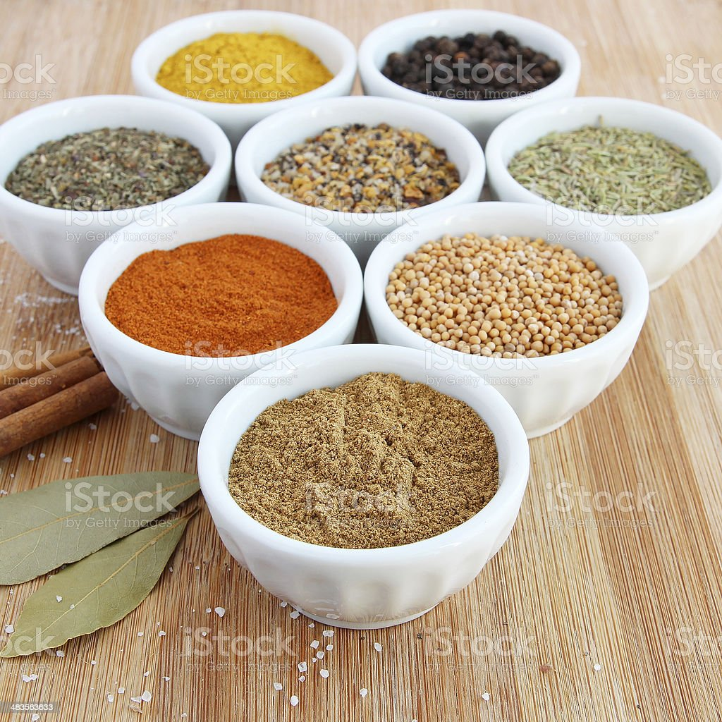 Spices in white bowls – Cumin in the foreground stock photo