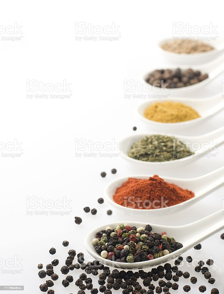 Spices in white spoons. royalty-free stock photo