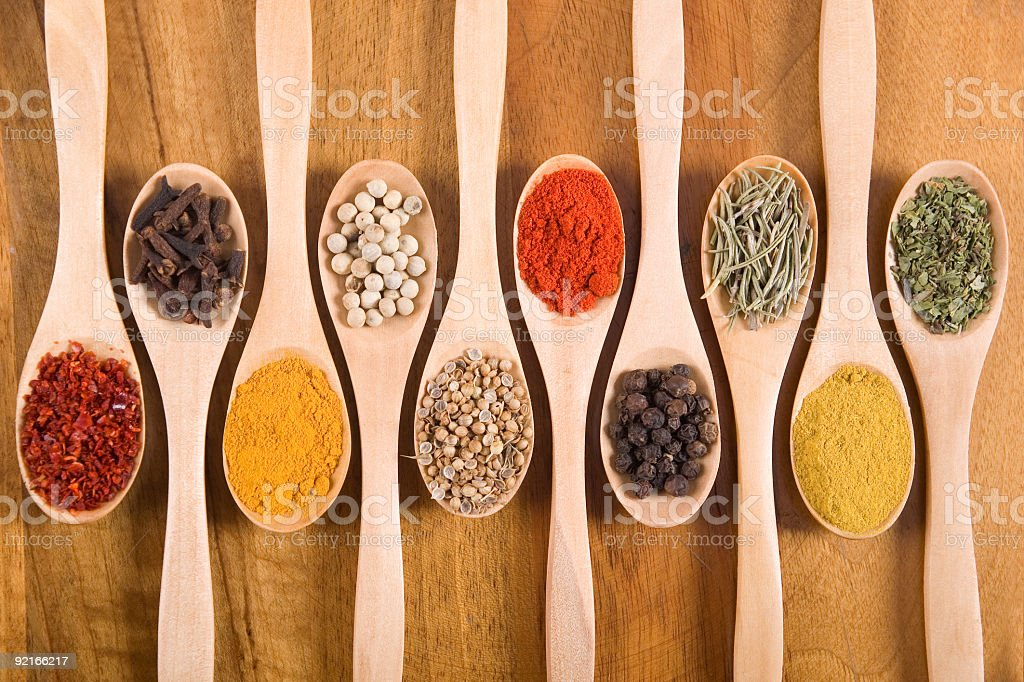 Spices in wooden spoons royalty-free stock photo