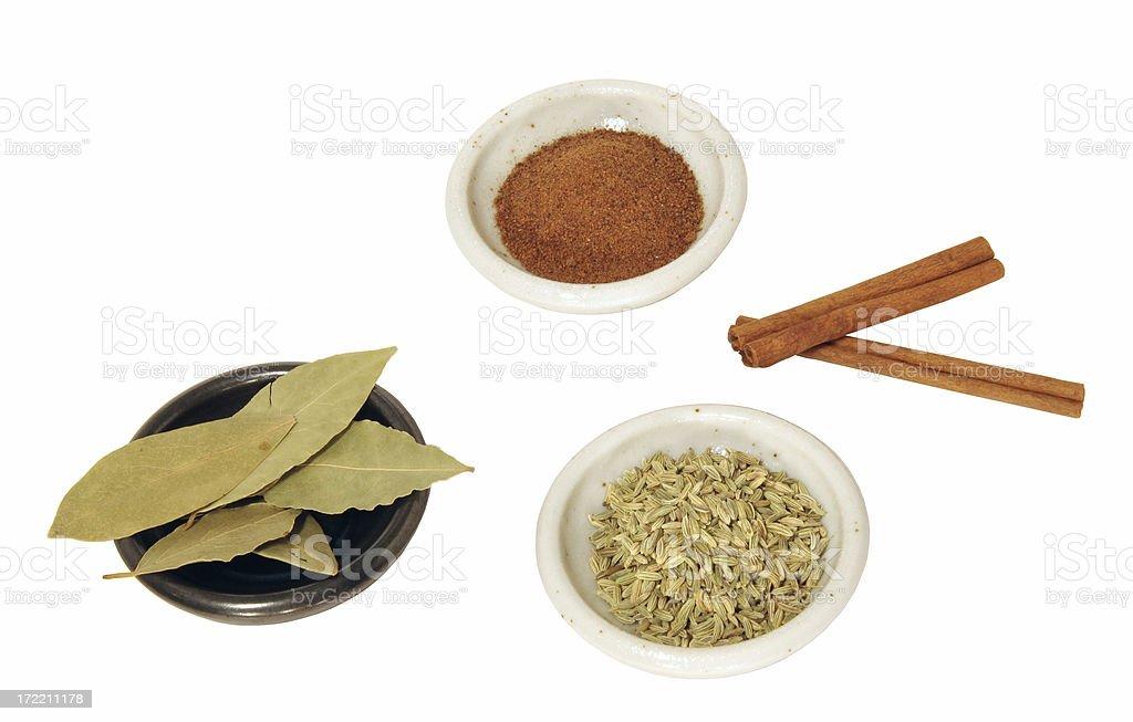 Spices - Nutmeg, Cinnamon, Bay Leaf, Fennel (Isolated) royalty-free stock photo