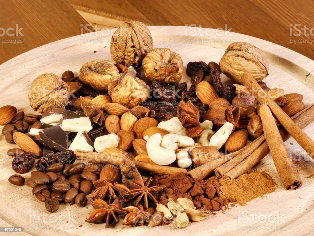 Spices, nuts, coffee and cinnamon royalty-free stock photo