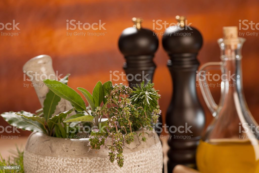 spices on a wooden table with mortar, pestle and mills. stock photo
