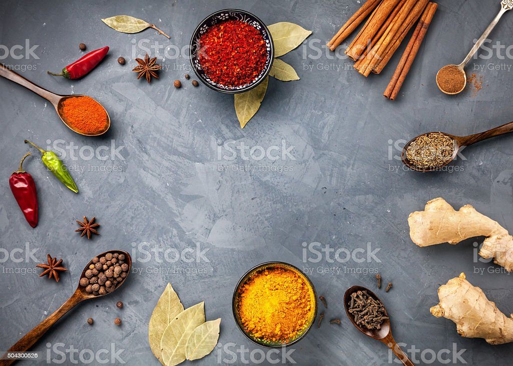 Spices on grunge grey background stock photo