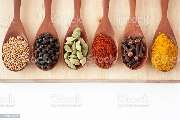 Spices On Spoons Stock Photo - Download Image Now