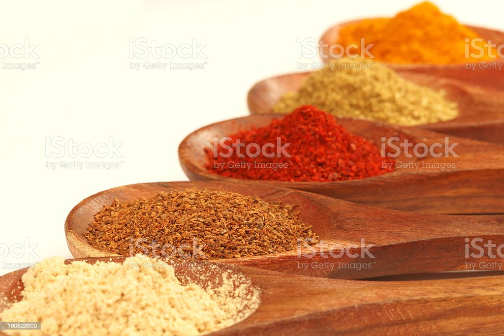 Spices on wooden spoon royalty-free stock photo
