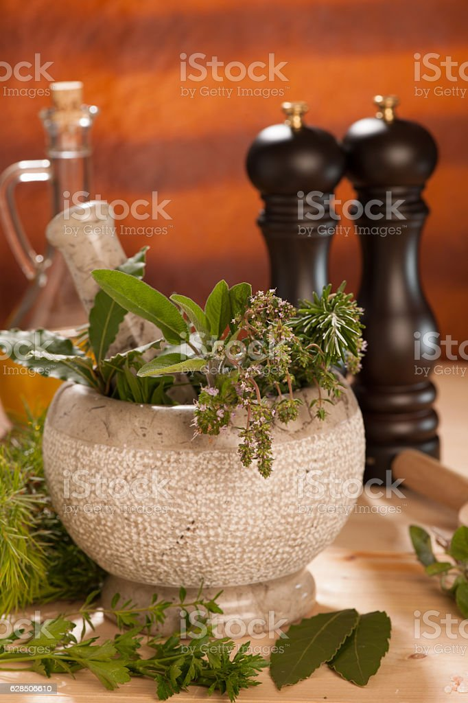 spices on wooden table with mortar stock photo
