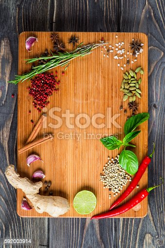 istock Spices over wooden background 592003914
