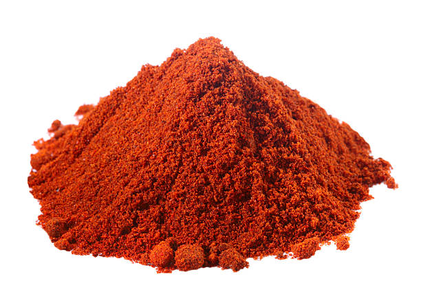 spices - pile of red paprika over white - paprikapoeder stockfoto's en -beelden