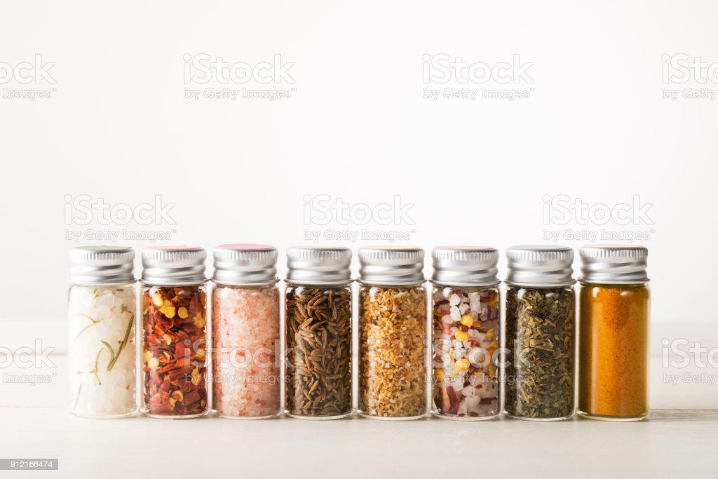 Spices Set in Mini Bottles stock photo