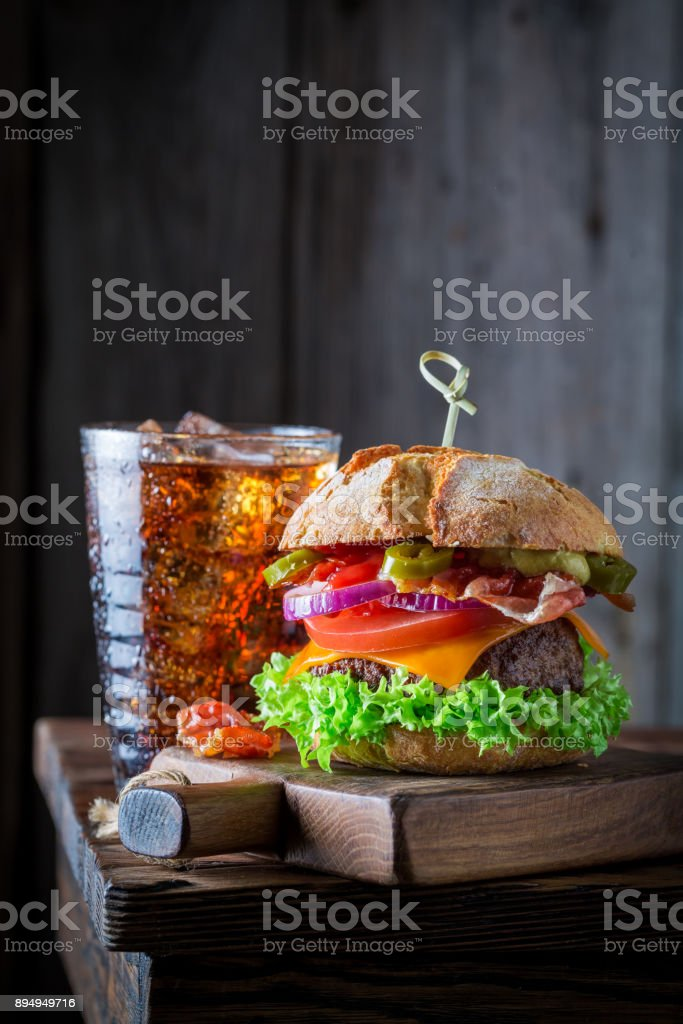 Spicy and fresh hamburger and cold drink with ice stock photo