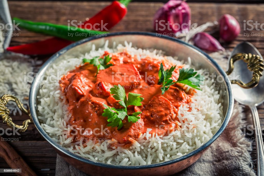 Spicy and sweet tikka masala with chicken in tomato sauce stock photo