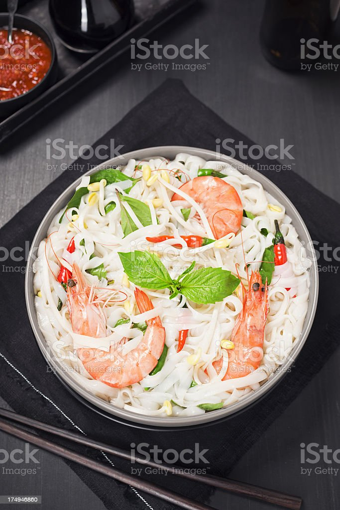 Spicy Asian Rice Noodle Soup with Shrimp and Basil royalty-free stock photo
