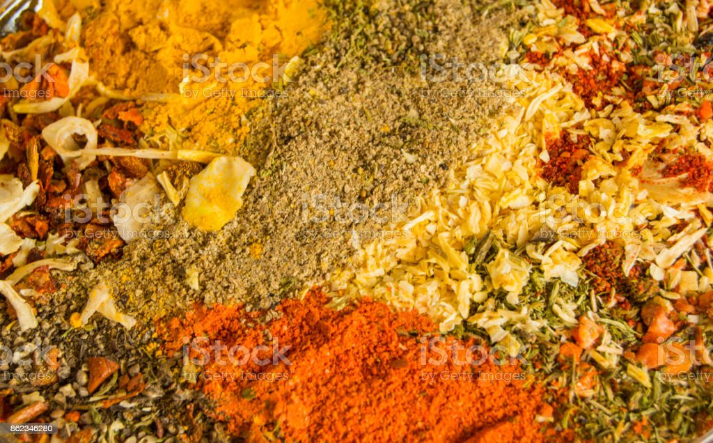 Spicy background with a variety of hot chili pepper, curry, pepper and a mixture of other spices. Copy space stock photo