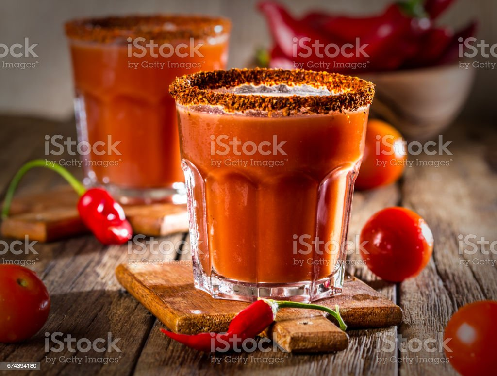 Spicy bloody Mary cocktail with smoked ground chili - merquen stock photo
