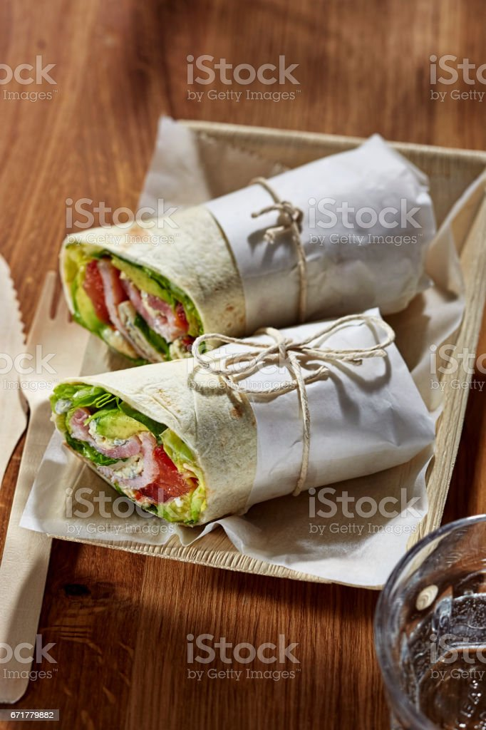 Spicy BLT bacon lettuce tomato wrap stock photo