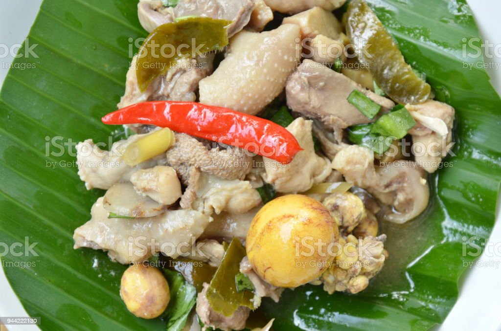 spicy boiled chicken and egg salad on banana leaf stock photo
