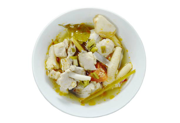 spicy boiled chicken with straw mushroom Tom Yum Soup stock photo