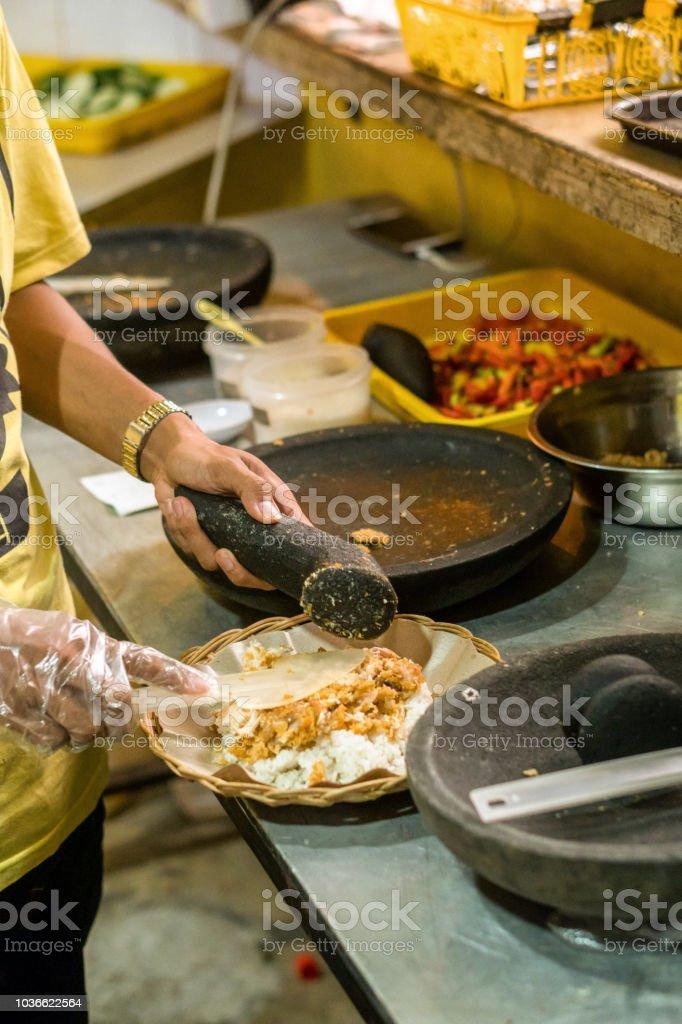 Spicy Chicken, Ayam geprek, Delicious Indonesian food stock photo