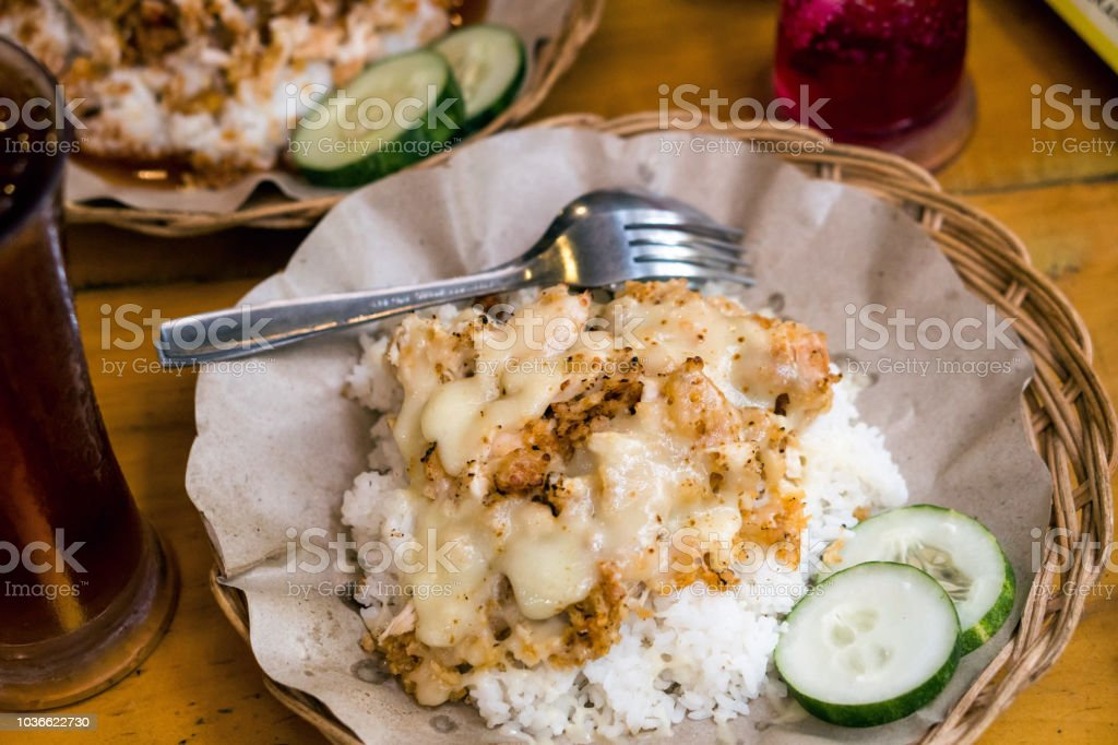 Spicy Chicken Geprek with Mozzarella cheese, Indonesian Food stock photo