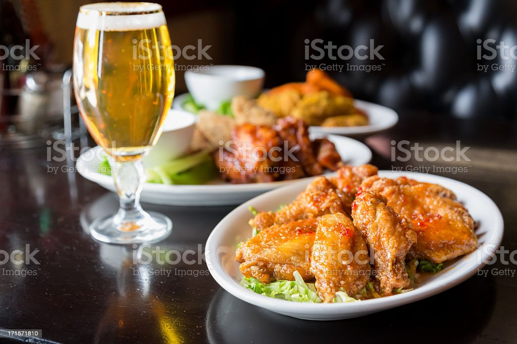 Spicy Chicken Wings and Beer royalty-free stock photo
