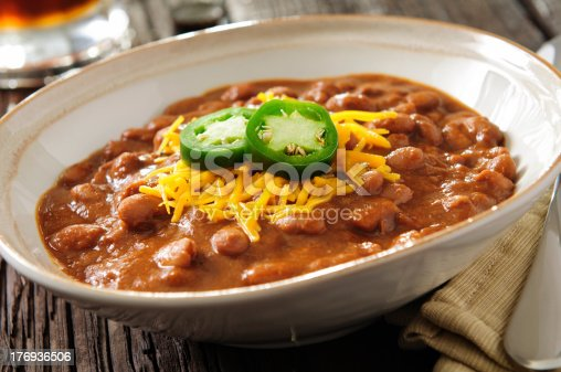 Bowl of chili with cheddar cheese and jalapeno and a beer.  Please see my portfolio for other food and drink images.