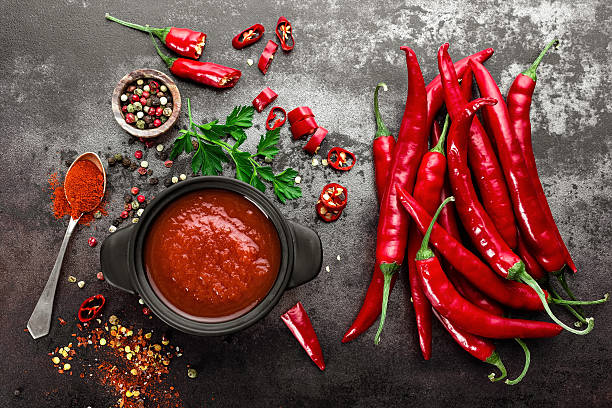 spicy chili sauce, ketchup spicy chili sauce, ketchup salsa sauce stock pictures, royalty-free photos & images