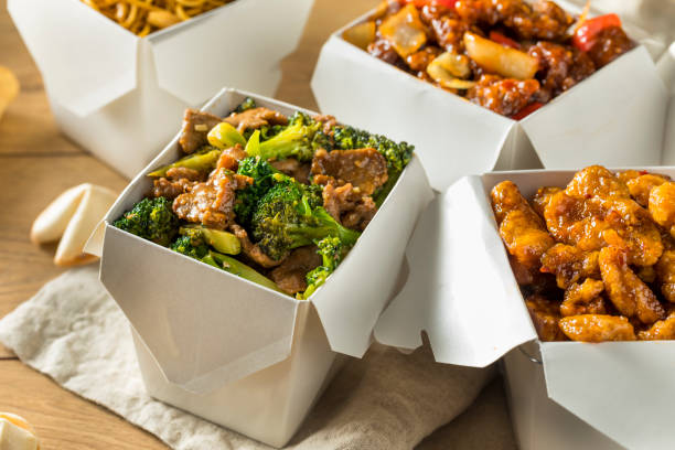Spicy Chinese Take Out Food Spicy Chinese Take Out Food with Chopsticks and Fortune Cookies chinese takeout stock pictures, royalty-free photos & images