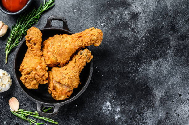 Spicy Deep Fried Breaded Chicken drumsticks. Black background. Top view. Copy space Spicy Deep Fried Breaded Chicken drumsticks. Black background. Top view. Copy space. southern usa stock pictures, royalty-free photos & images