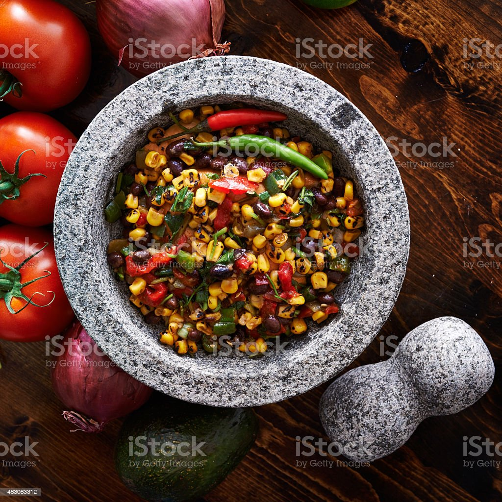 spicy fire roasted black bean and corn salsa stock photo