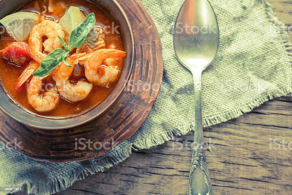 Spicy french soup with seafood stock photo