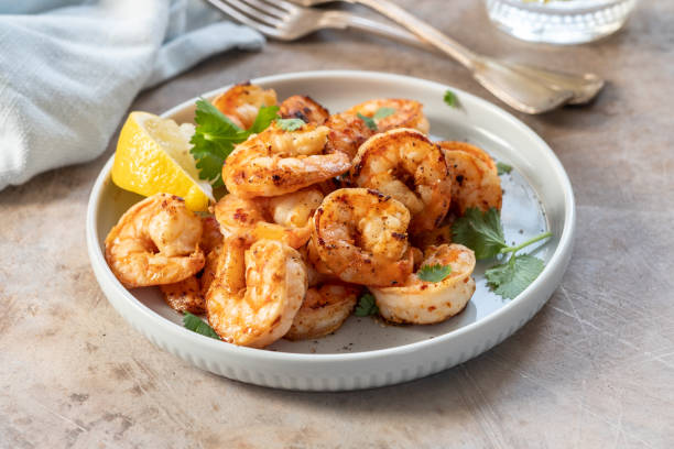 Spicy garlic chili Prawns Shrimps Spicy garlic chili Prawns Shrimps with lemon and cilantro cooked stock pictures, royalty-free photos & images