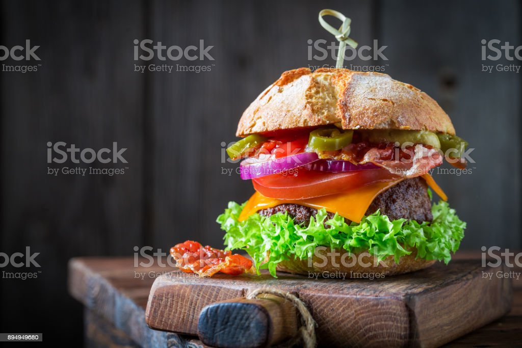 Spicy hamburger with lettuce, beef and cheese stock photo
