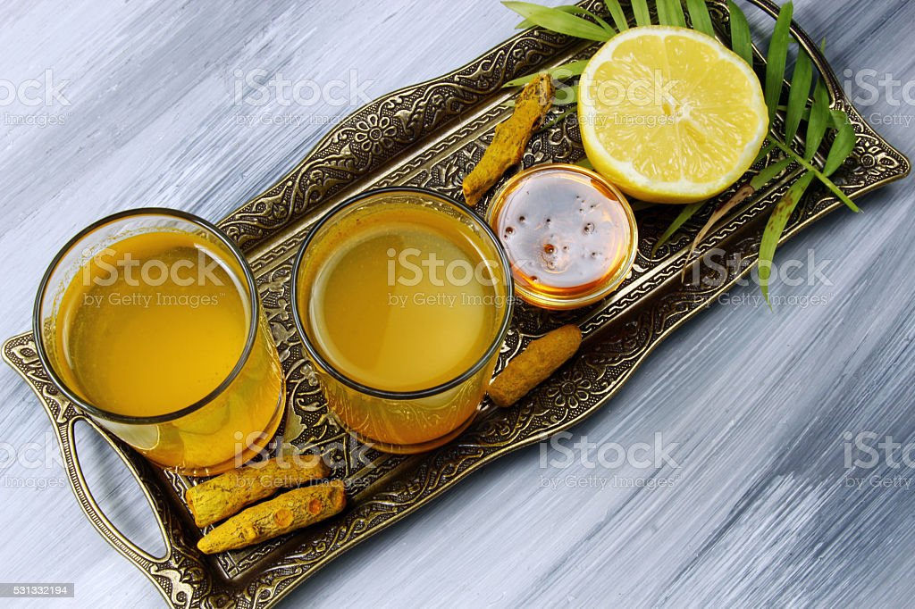 Spicy healthy Haldi or Turmeric and lemon drink stock photo