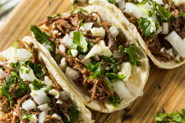 spicy homemade beef barbacoa tacos - mexican food stock photos and pictures