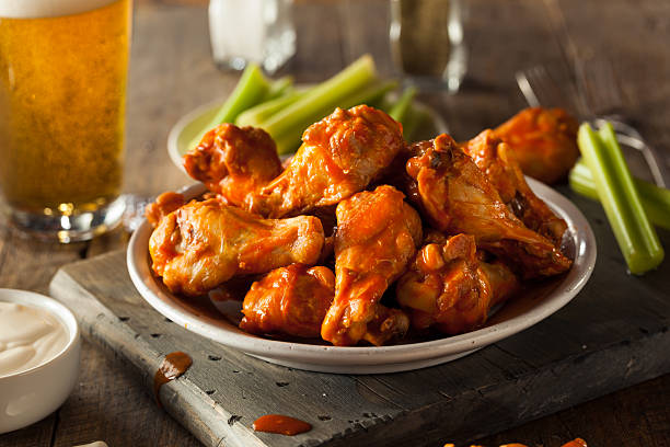 spicy homemade buffalo wings - animal wing stock photos and pictures