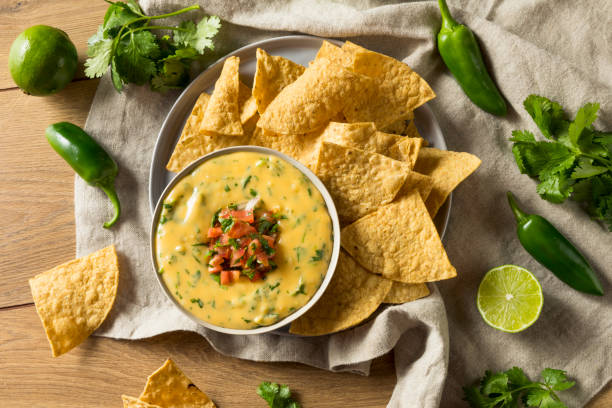 Spicy Homemade Cheesey Queso Dip Spicy Homemade Cheesey Queso Dip with Tortilla Chips dipping sauce stock pictures, royalty-free photos & images