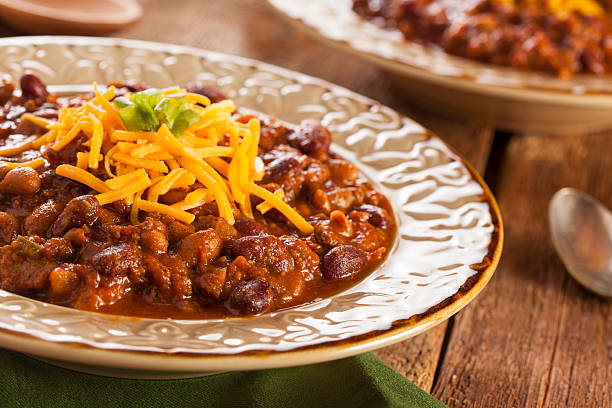 spicy homemade chili with carne soup cheese topped - texmexsoppa bildbanksfoton och bilder