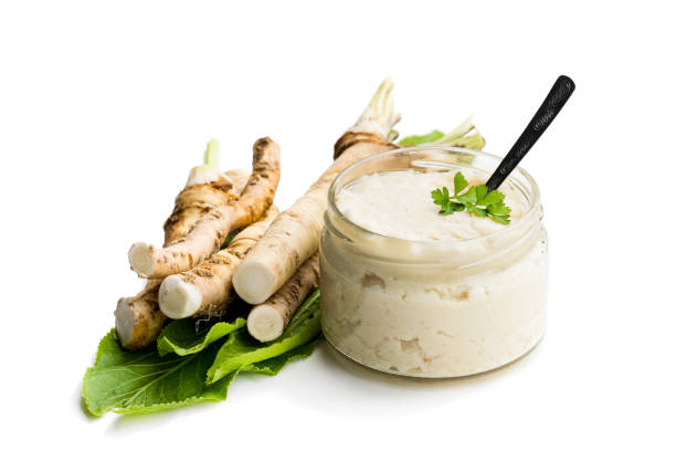 Spicy horseradish sauce in glass jar isolated on white Spicy  horseradish sauce in glass jar isolated on white horseradish stock pictures, royalty-free photos & images